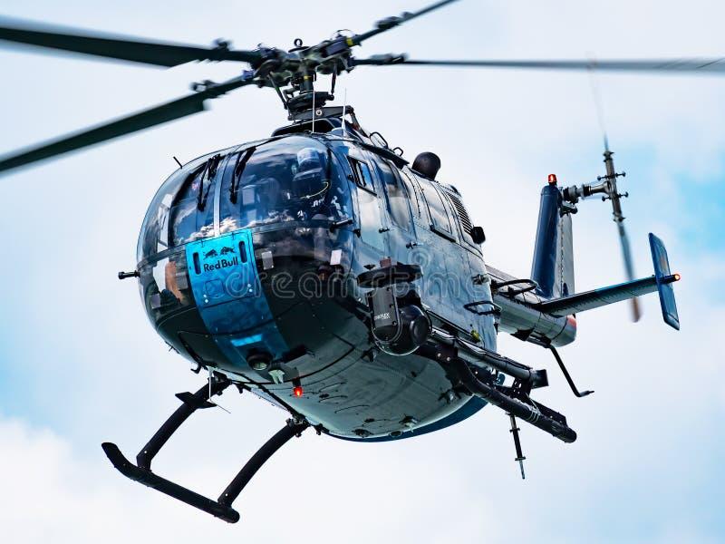 Red Bull Flying Bulls MBB Bo 105 D-HUDM helicopter flying over Lake Balaton for Red Bull Air Race 2019 royalty free stock photography