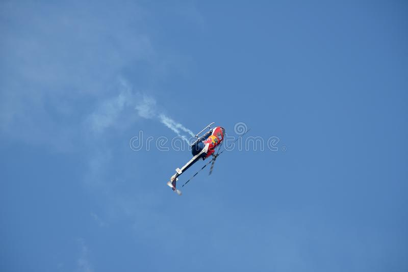 Red Bull helicopter performing during air show royalty free stock image