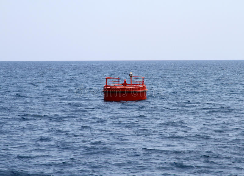 Red buoy. A red traffic buoy in the harbor royalty free stock photo