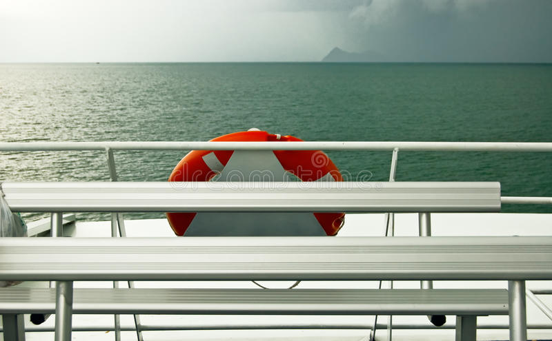 Red buoy. White ship deck with red buoy royalty free stock photos
