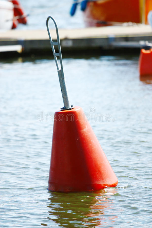 Red Buoy. A red buoy floating on boat parking stock photography