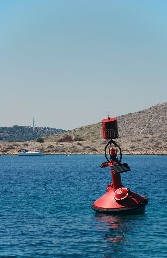 Red buoy. On the sea royalty free stock image