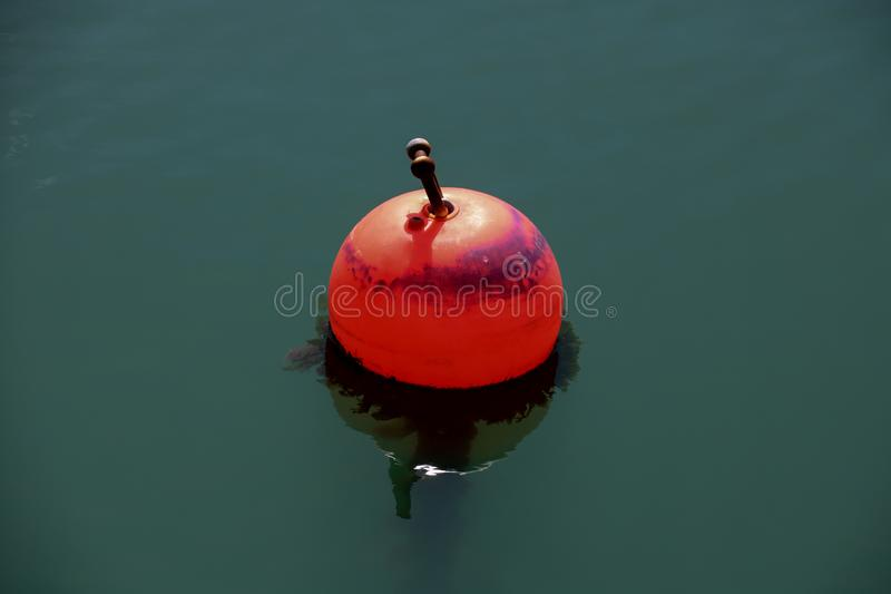 Red Buoy at a Coastal Harbour. Red buoy floating at a coastal harbour royalty free stock photography