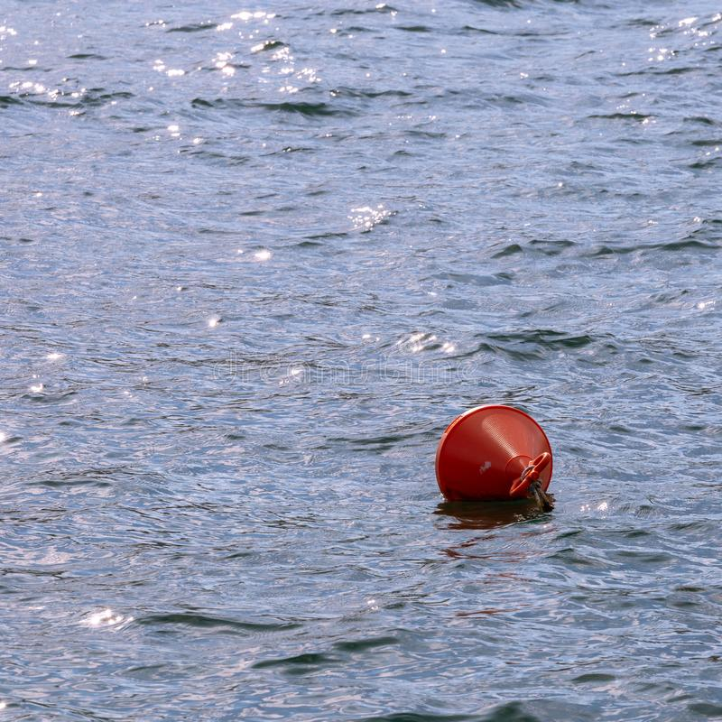 The red buoy. Floating in the middle of the sea royalty free stock image