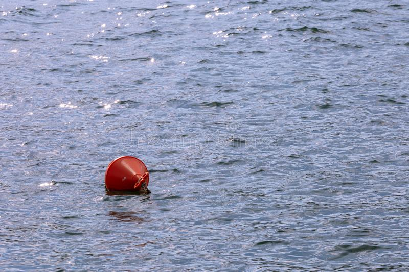 The red buoy. Floating in the middle of the sea stock image
