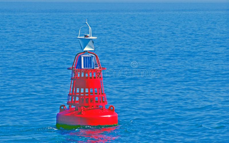 Red buoy floating in the water of the Wadden Sea stock photography