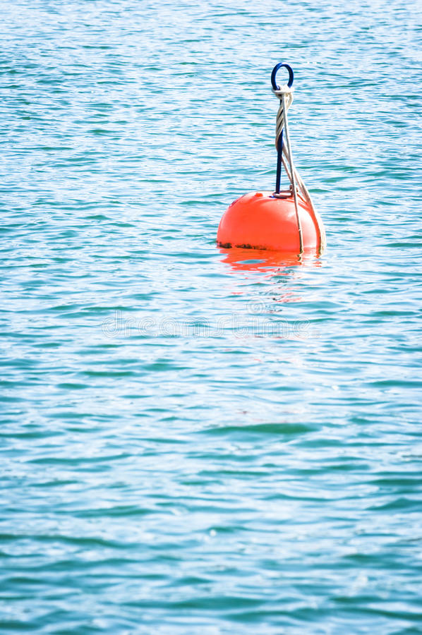 Red buoy. At a lake royalty free stock image