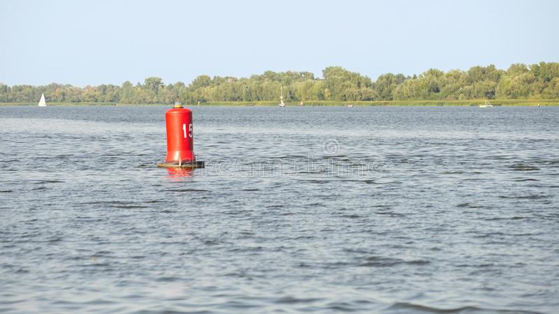 Red Buoy on the River. A red buoy on the Dnieper river in Kiev, Ukraine, for the safety and security of the boats travelling on the water royalty free stock photo