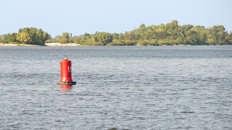 Red Buoy on the River. A red buoy on the Dnieper river in Kiev, Ukraine, for the safety and security of the boats travelling on the water stock image