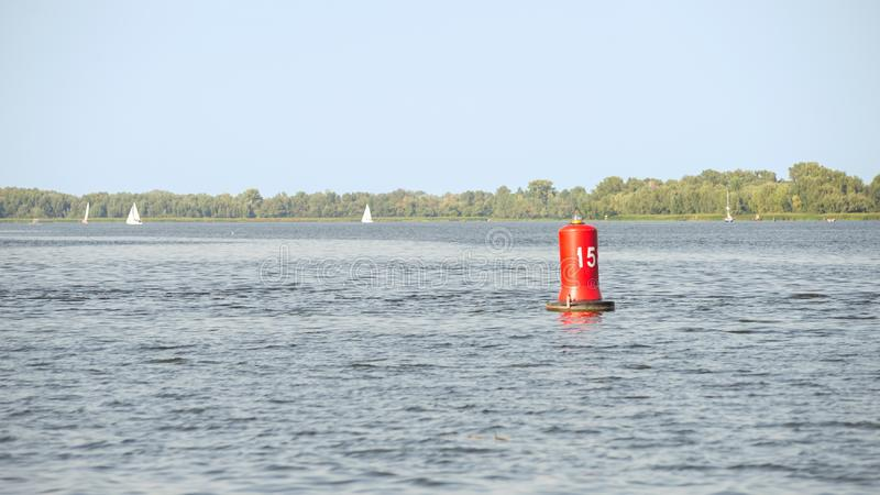 Red Buoy on the River. A red buoy on the Dnieper river in Kiev, Ukraine, for the safety and security of the boats travelling on the water stock photos