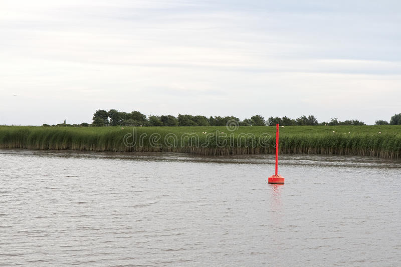 Red Buoy in the River. Eider in the northern part of Germany royalty free stock photo