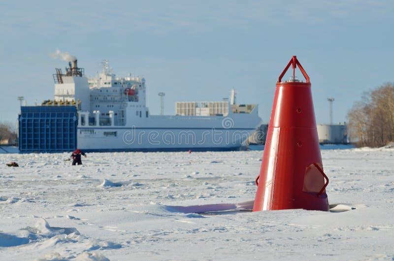 The red buoy on the river. The red buoy on the frozen river.This luminous landmark for ships royalty free stock image