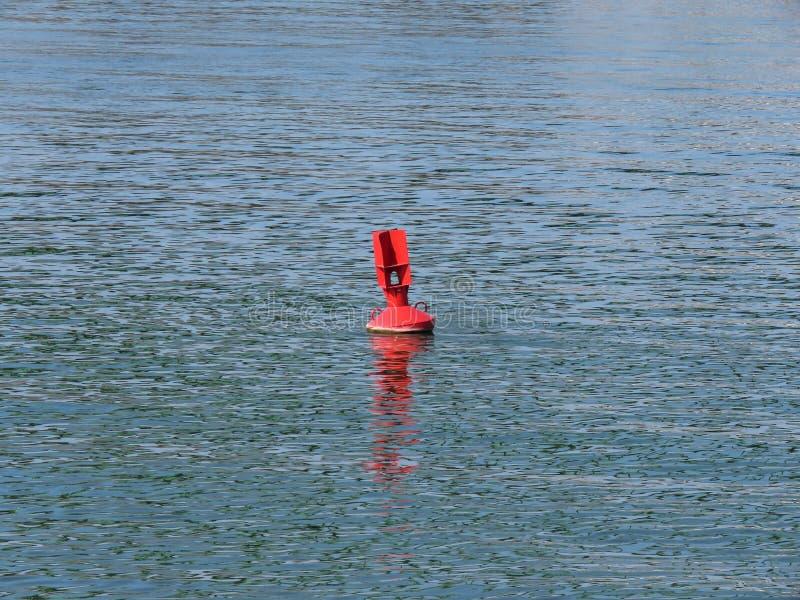 Red buoy in river. Red buoy in Sava river,Belgrade,Serbia stock photo