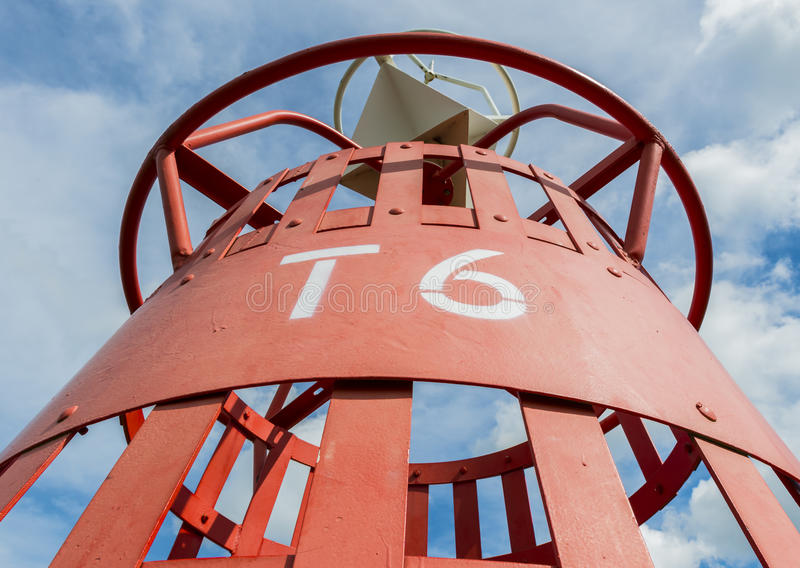 Red buoy T6. Red and white buoy in the harbour of Oudeschild on the isle of Texel royalty free stock photos