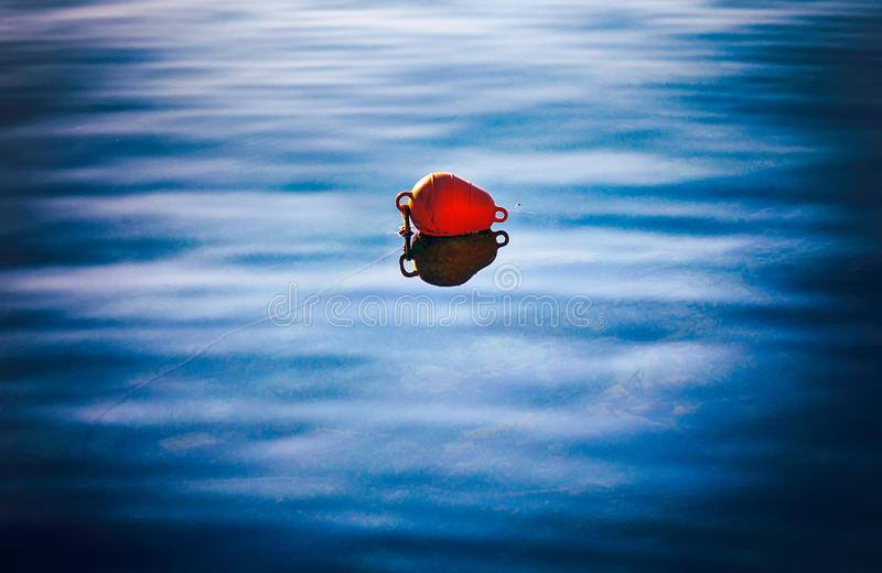 Red buoy on water. Red buoy on the water royalty free stock photos