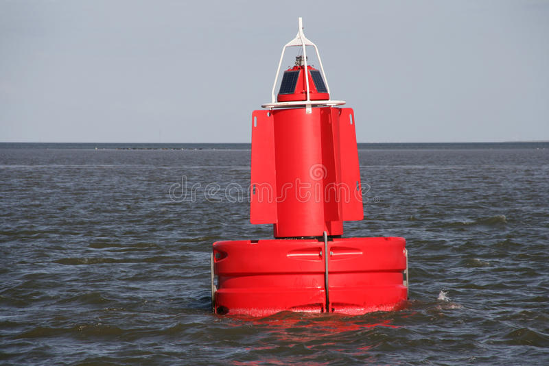 Red buoy. A red buoy in the water royalty free stock photography