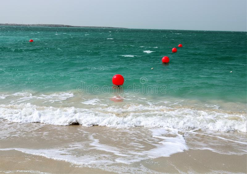 Red buoys on water. stock photo