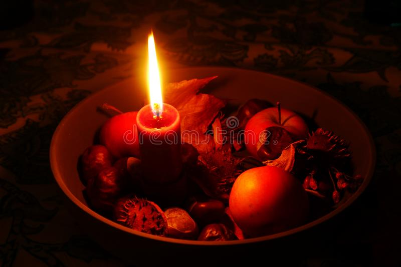 Red burning candle in a bowl stock photo
