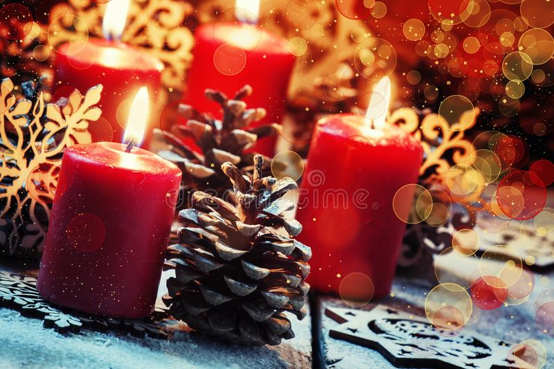 Red burning candle with pine shikami and snowflakes, Christmas a stock images