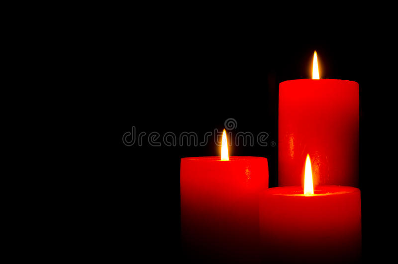 Red burning candles for Christmas royalty free stock photography