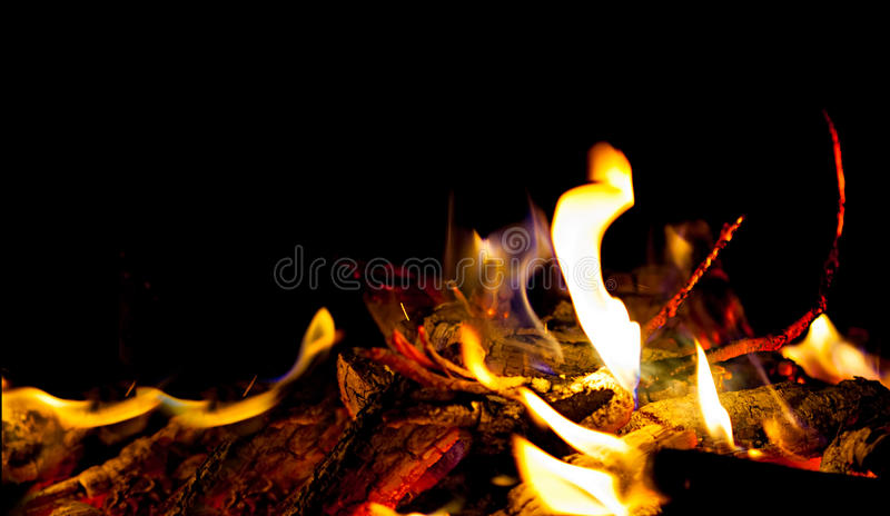 Red burning hot coals in stove.  royalty free stock photos