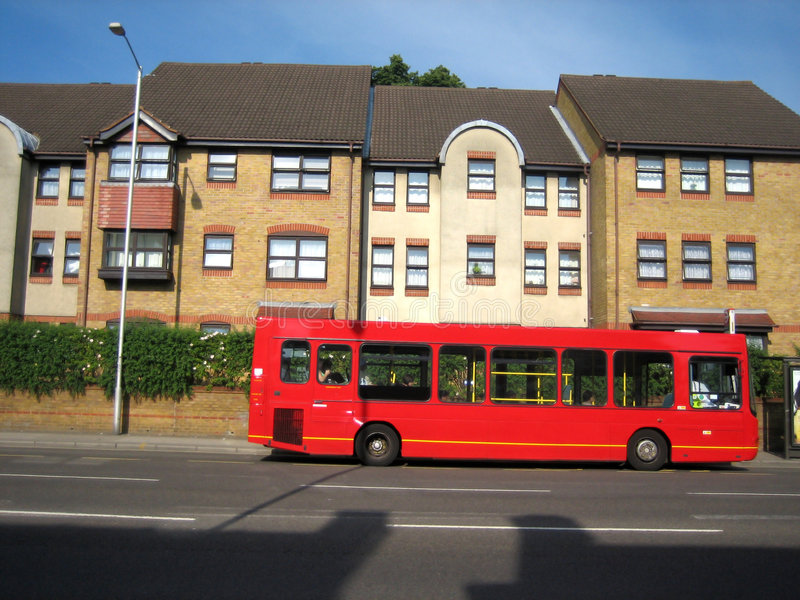 Red bus. Stopped in a bus-stop in London stock photography