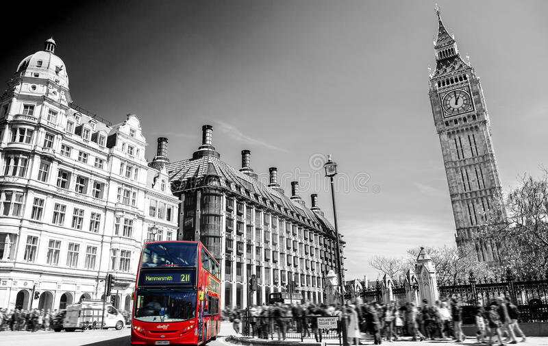 Red bus in Lodon street view with Big Ben in panorama , black and white royalty free stock photo