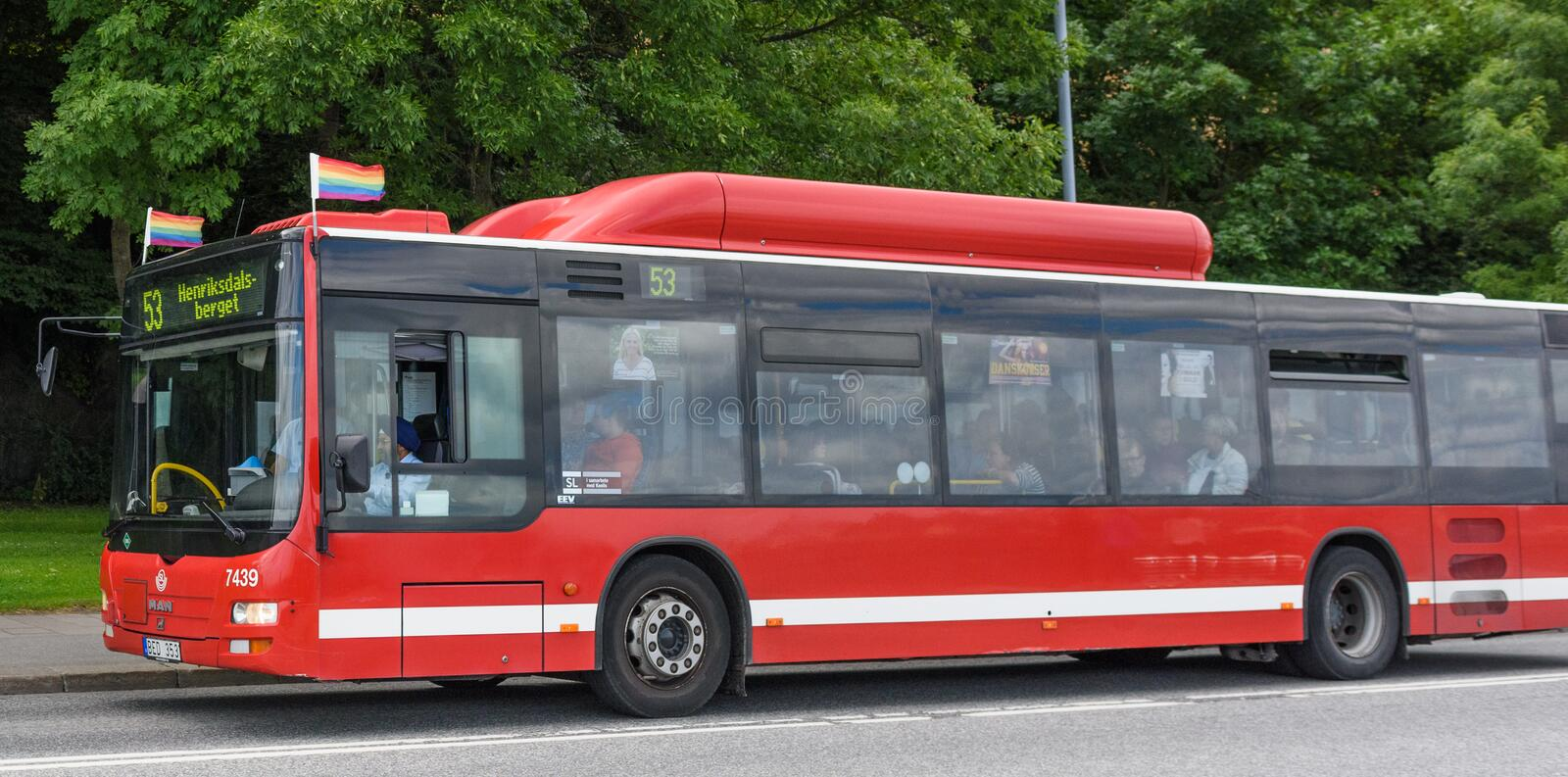 Red bus with pride flags. Stockholm, Sweden - July 27, 2015: Red bus in traffic for SL traffic on line 53 with the destination Henriksdalsberget, with pride stock photography