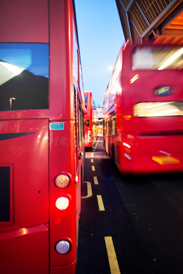 Red bus traffic by night in London royalty free stock images