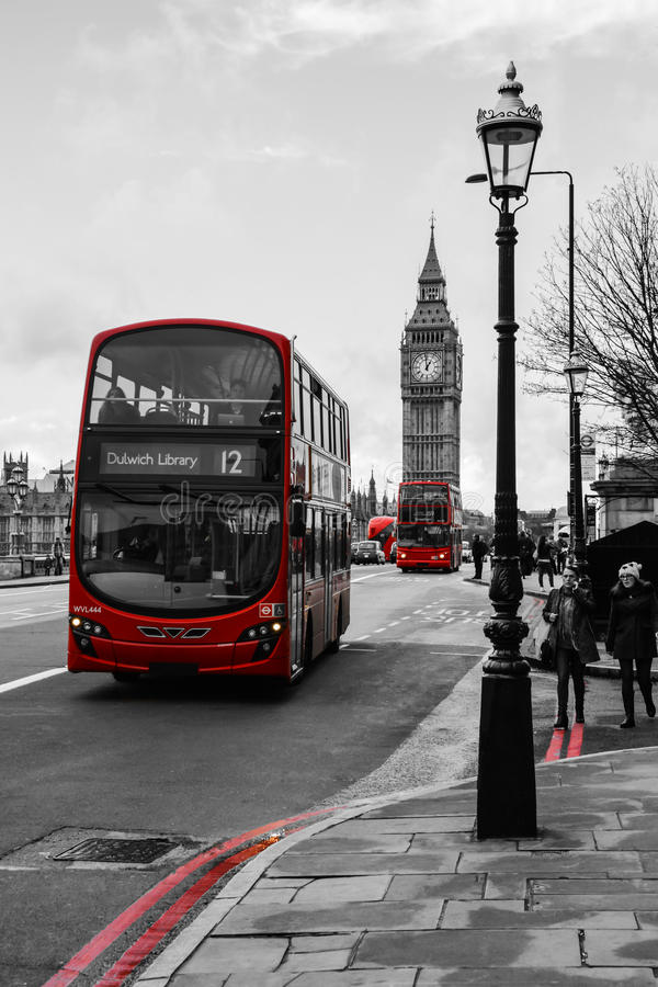 Red buses - Westminster Bridge. A picture of two red buses travelling across Westminster Bridge in front of the iconic Big Ben (London stock images
