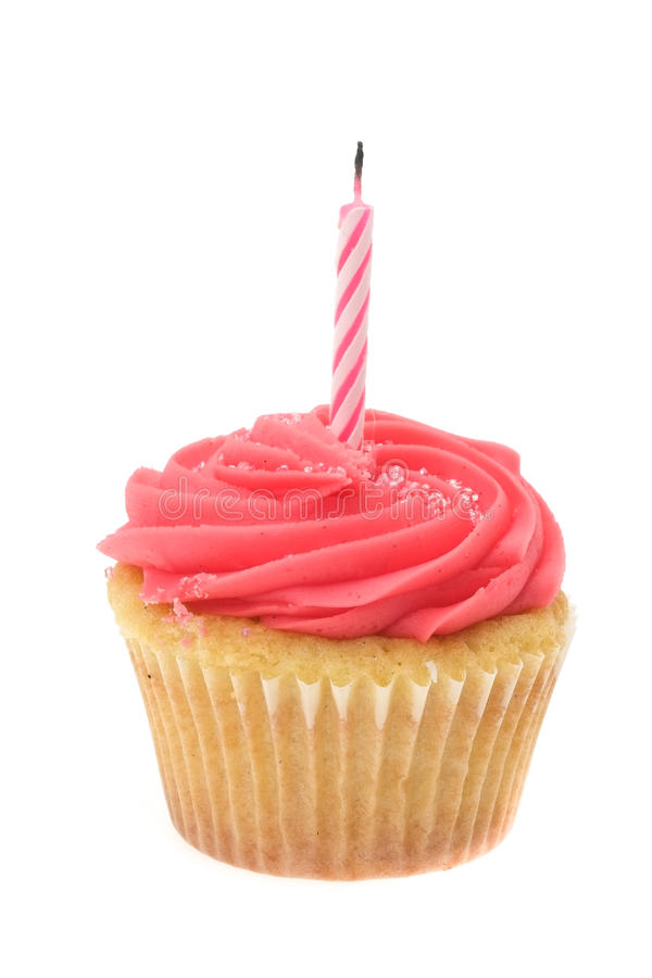 Red buttercream iced cupcake with a single birthday candle. Studio shot with a white background royalty free stock photography