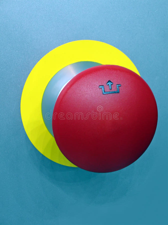 Red button on blue metallic surface, security stock photo