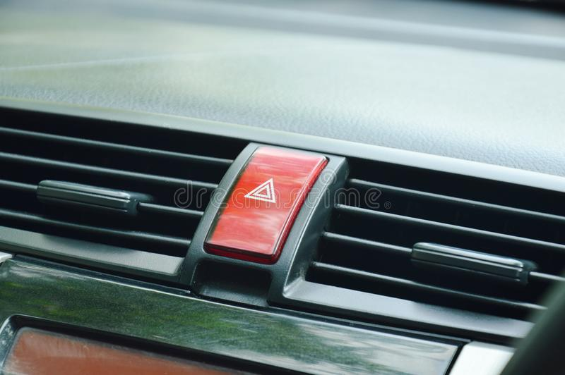 Red button for open emergency light in car royalty free stock photography