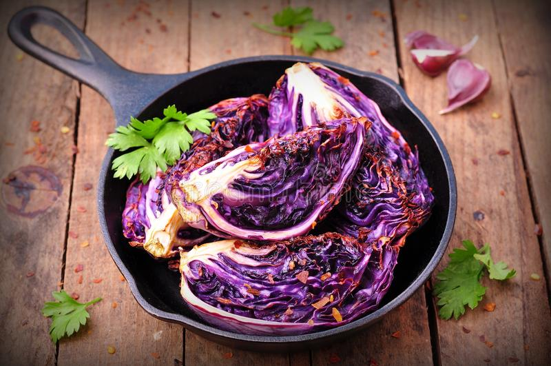 Red cabbage baked in olive oil with chili pepper flakes and sea salt. vegetarian food. image is tinted. rustic style royalty free stock photos