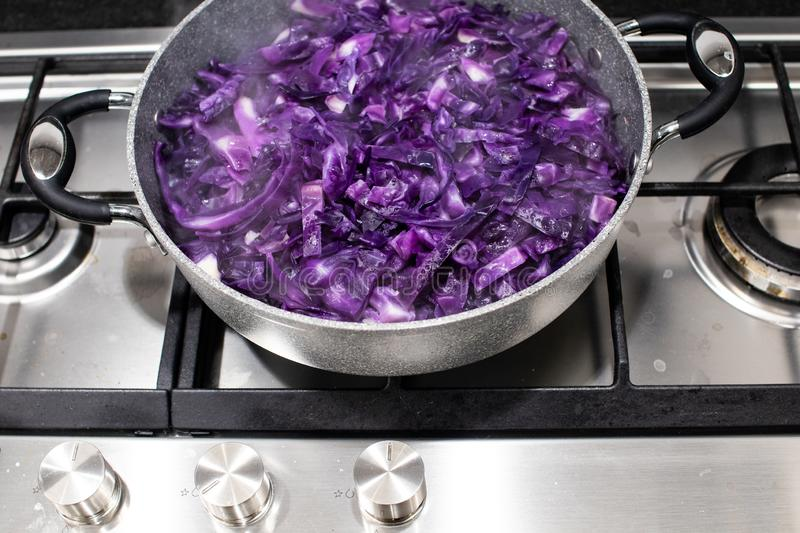 red cabbage cut into strips and placed in the pot to be cooked a royalty free stock photo
