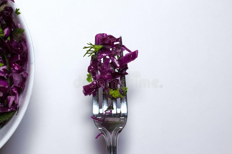 Red Cabbage salad for Christmas dinner. Vegetarian dish. on white background. royalty free stock photo