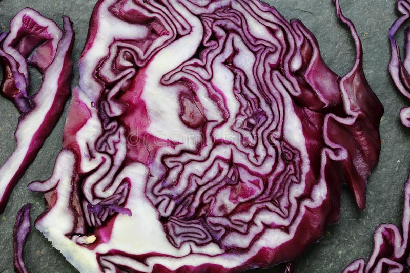 Red cabbage on slate background royalty free stock photo