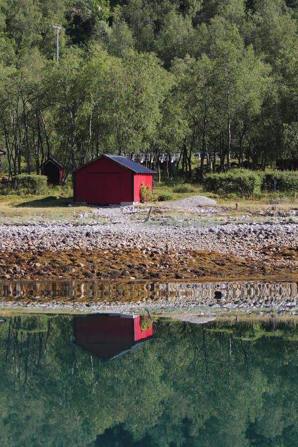 Red cabin of Meloey. Small boat house of an island of Norwegian polar cregion royalty free stock photography