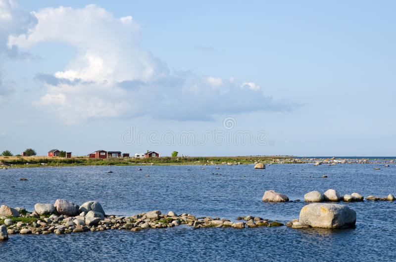 Red cabins at rocky coast