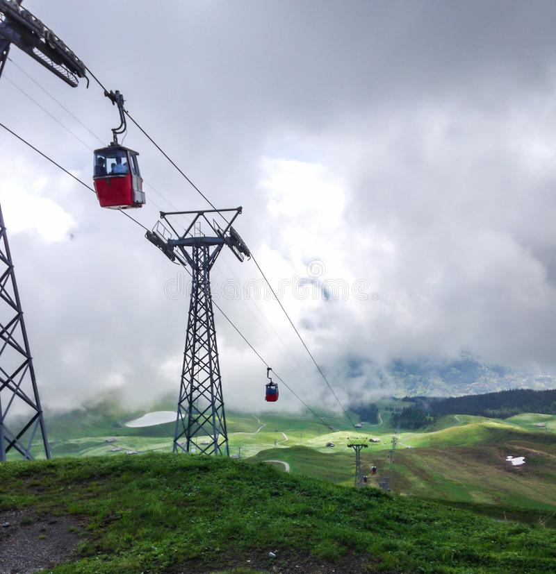 Red cable cabin down from Mannlichen with scenic view in direction to Grindelwald, Switzerland, Europe stock photography