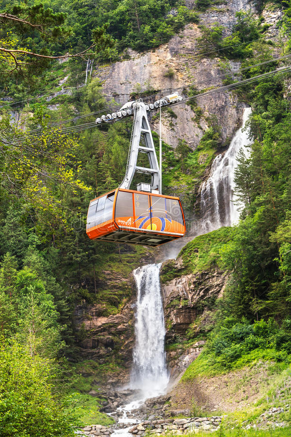 Free Red Cable Car On The Background Of A Waterfall Royalty Free Stock Photo - 80684435