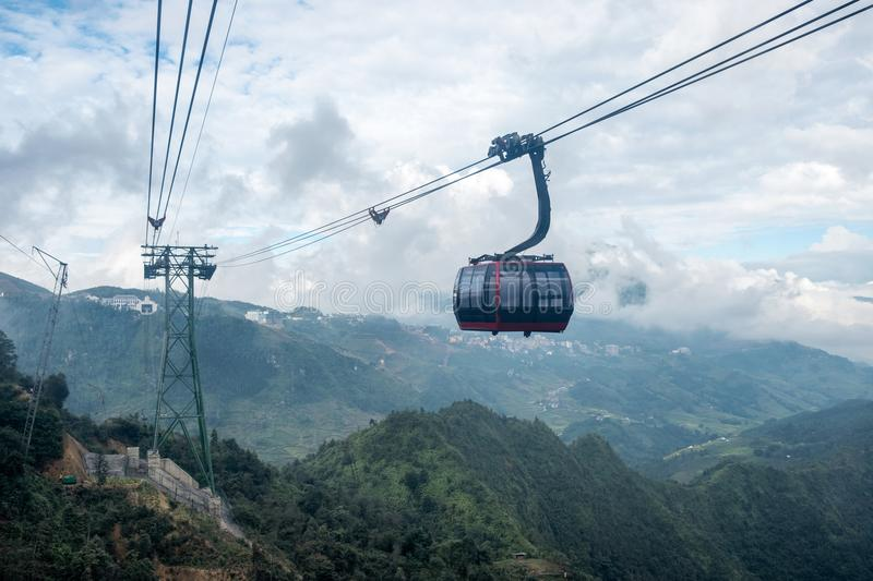 Red cable car sightseeing Sapa village in valley. Through on fog royalty free stock images
