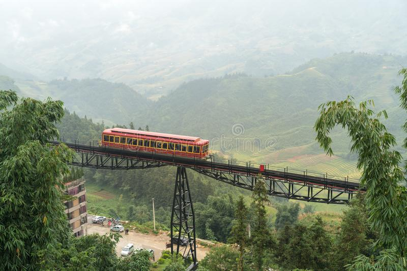 Red cable car to the top of the Fansipan mountain in Sapa town, Lao Cai, Vietnam.  royalty free stock photography