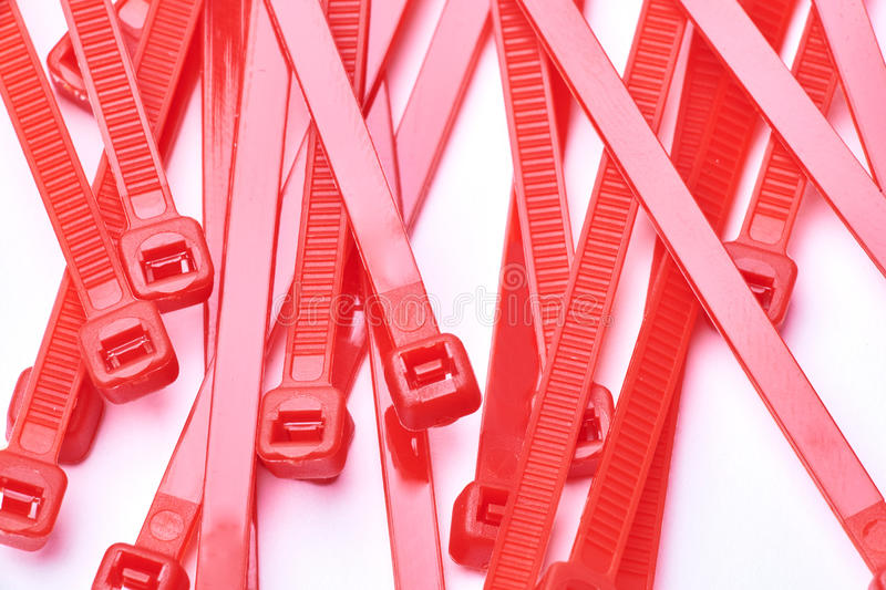 Red cable ties. Commercial photo on white background. royalty free stock photo