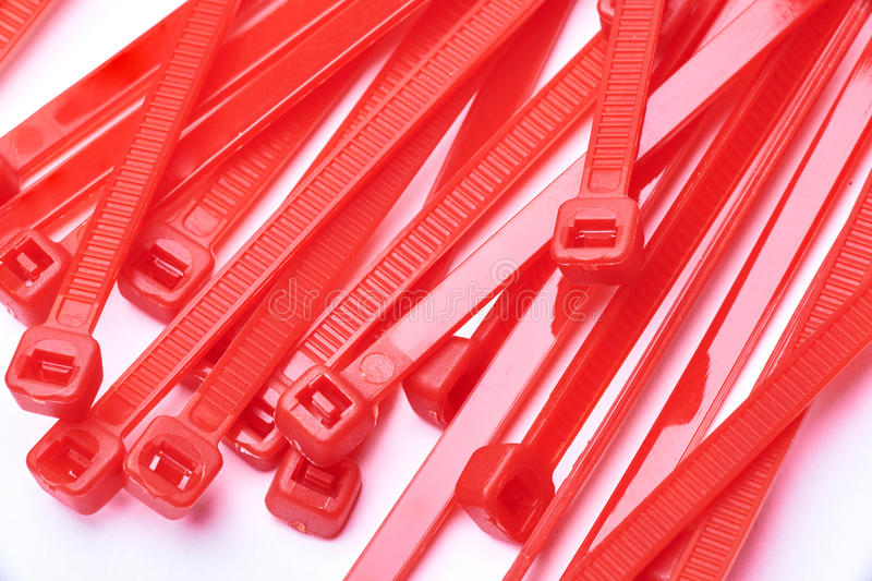 Red cable ties. Commercial photo on white background. royalty free stock photography