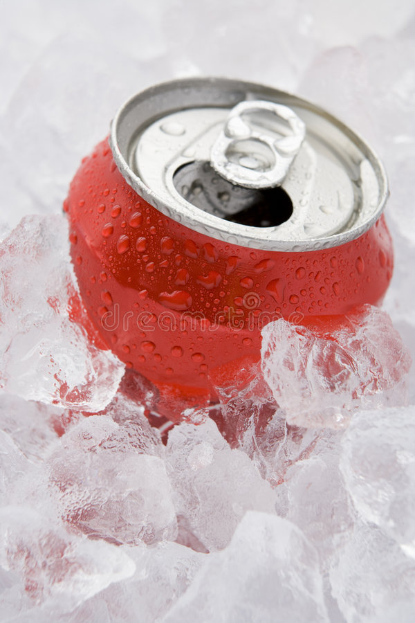Red Can Of Fizzy Soft Drink Set In Ice. With The Ring Pulled royalty free stock photography