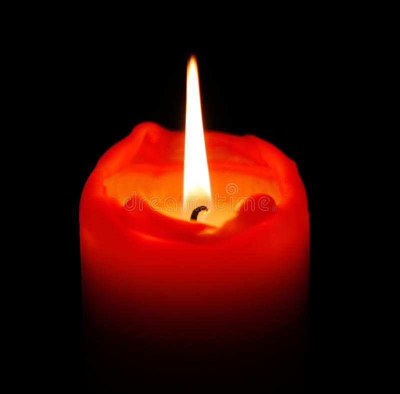 Red Candle. On a black background royalty free stock image