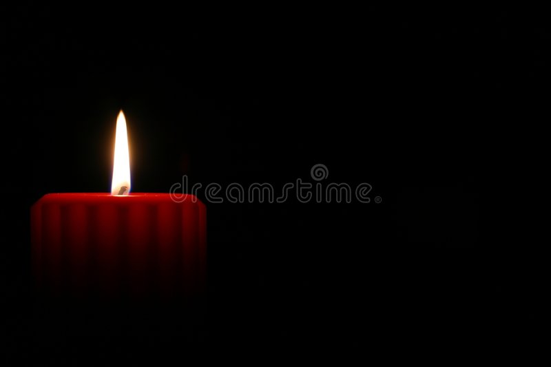 Red Candle 2. A single red candle burning alone in the dark. Could symbolize peace, love, hope or patience. There is room to the side for a message or graphic royalty free stock photos