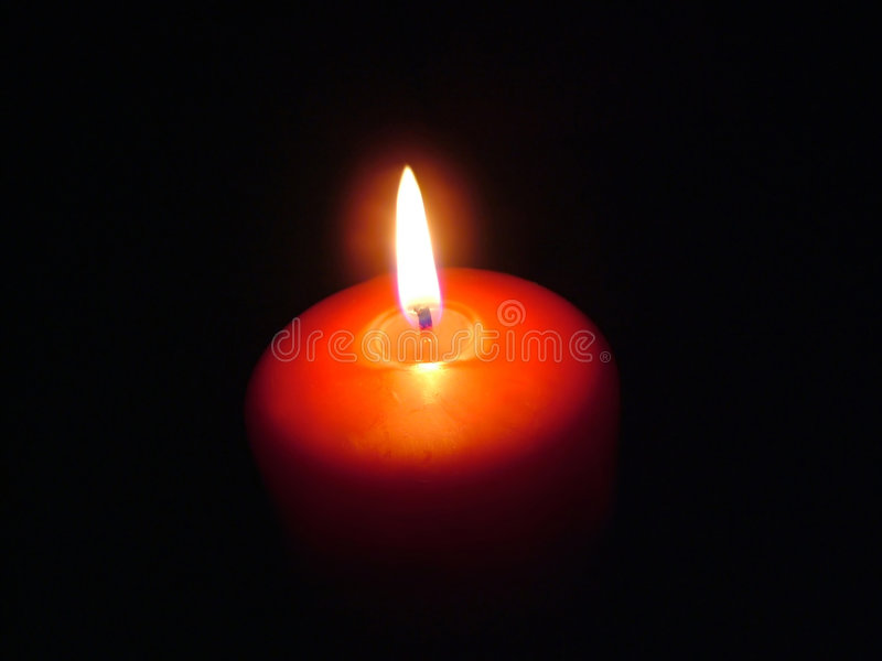 Red Candle. In the dark royalty free stock photos