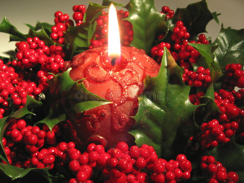 Red candle. In holly wreath stock images